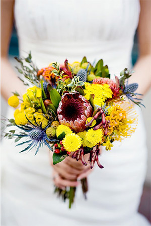 Unique wedding bouquet with protea, thistle and kangaroo paw